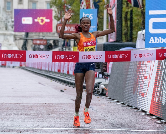 Brigid Kosgei of Kenya celebrates as she crosses the finish line to win the Elite Women's Race at the London Marathon 2020 in central London, Britain, on Oct. 4, 2020.