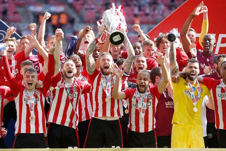 The Bees secured a first season in English top flight football in 74 years, with a 2-0 win over Swansea in the Championship Playoff final.