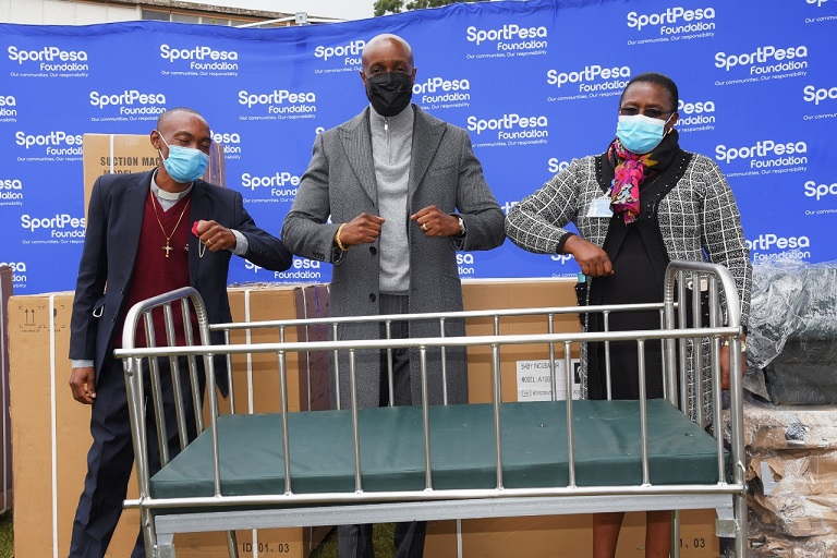 SportPesa CEO Captain Ronald Karauri poses for a picture with one of the beds donated to the Chogoria Mission Hospital on Friday, July 30, 2021. PHOTO   SPN