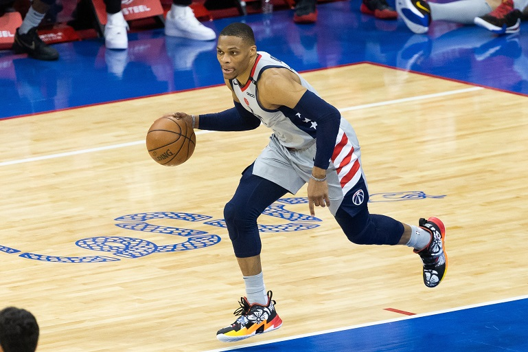 Washington Wizards guard Russell Westbrook (4) dribbles the ball up court against the Philadelphia 76ers during the fourth quarter in game five of the first round of the 2021 NBA Playoffs at Wells Fargo Center.