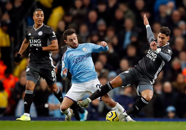 Manchester City's Bernardo Silva (centre) and Leicester City's Ayoze Perez (right) battle for the ball during the Premier League match at the Etihad Stadium, Manchester.