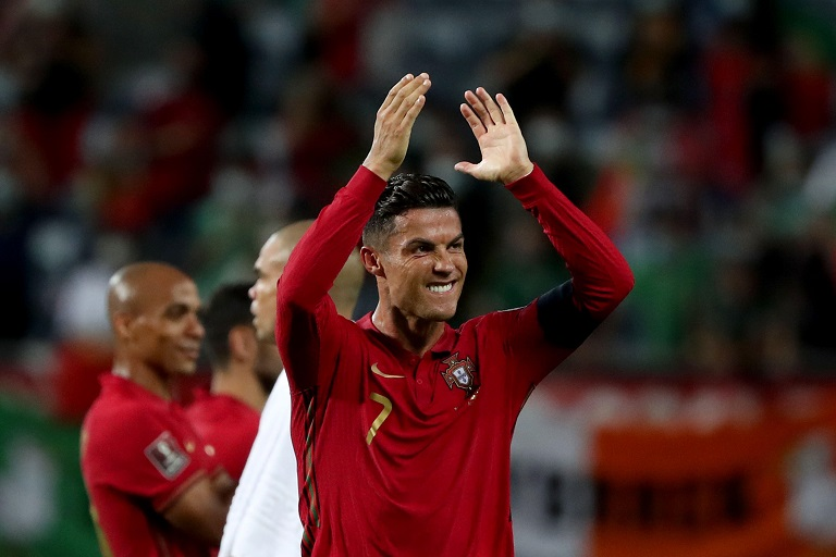 Portugal's forward Cristiano Ronaldo celebrates after scoring his second goal during the FIFA World Cup 2022 European qualifying round group A football match between Portugal and Republic of Ireland, at the Algarve stadium in Faro, Portugal, on September 1, 2021.